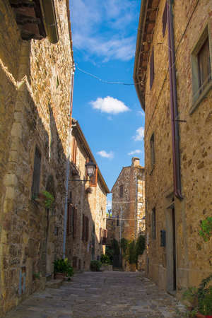A quiet street of residential buildings in the historic medieval village of Montefioralle near Greve in Chianti in Florence province, Tuscany, Italy