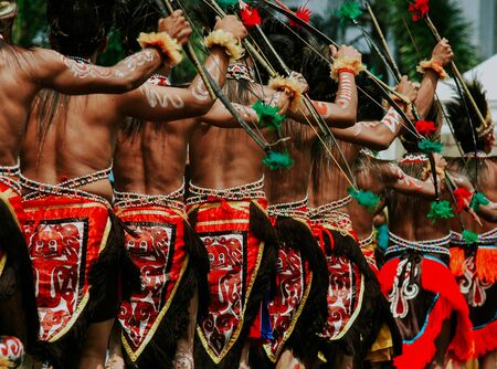 Papua Festival performing the men use traditional cloth and hold arrows