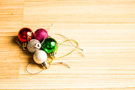 color balls: Color balls christmas left side on a wooden brown floor background. Stock Photo