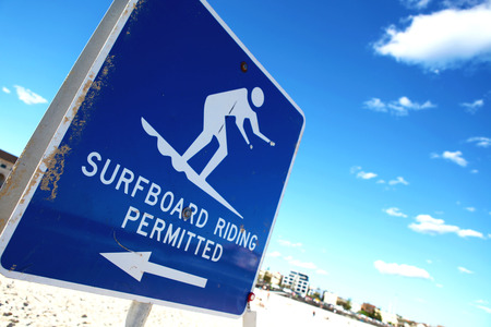 permitted: a surfboard riding permitted sign at Bondi beach, Australia Stock Photo