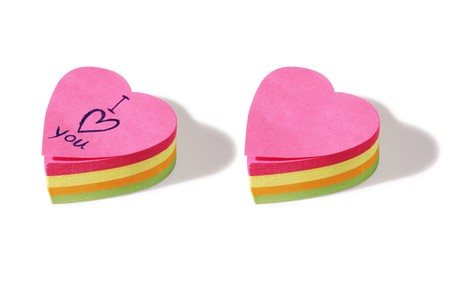 two piles of heart shaped post it notes. One blank and one with the message 'I love you'  Stock Photo - 7456147
