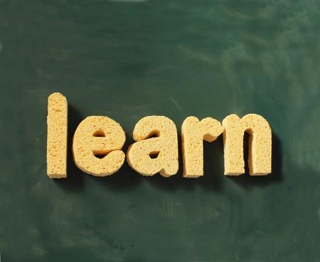 the word learn on a blackboard background photo