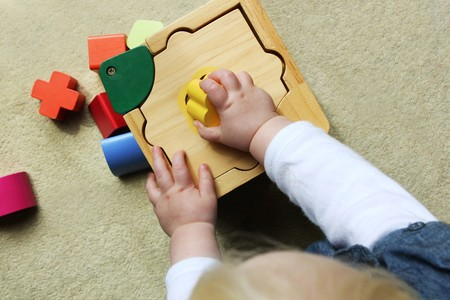 plating: child plating with shape sorter Stock Photo