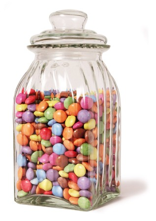 smarties: traditional sweet jar full of smarties on a white background