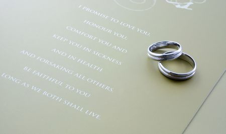 wedding vows: A pair of wedding rings with wedding vows