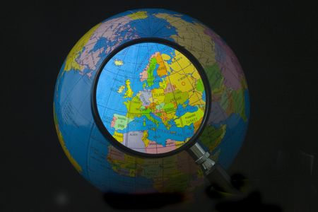 Magnifying glass focusing on Europe Stock Photo