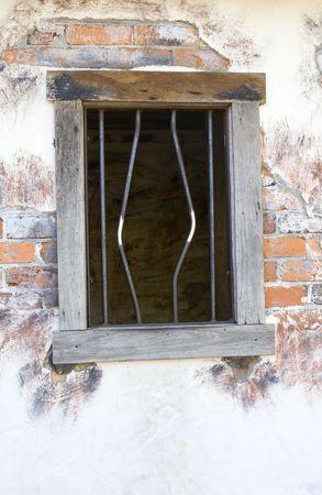 Bended bars on a window frame depicting jailbreak