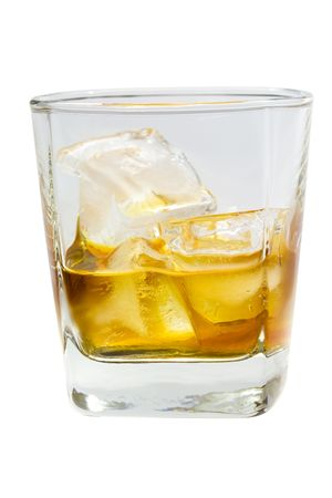 Glass of whiskey and ice isolated on white background photo