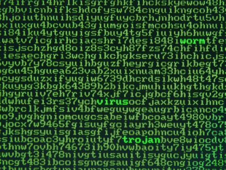 Screen full of alphanumerics with emphasis on the words virus, worm and trojan Stock Photo