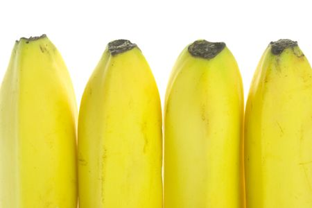 Row of ripened banana isolated on white background photo