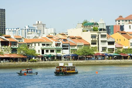 View of Singapore River with row of shophouses along its bank.