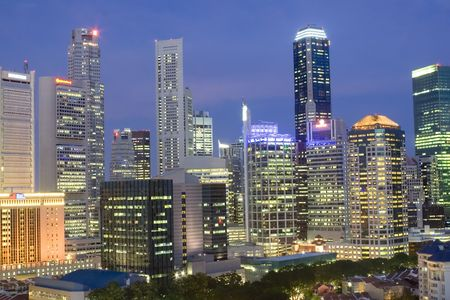 Cityscape of Singapore at dusk showing the financial district and shophouses in the foreground photo