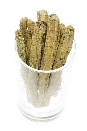 traditional chinese medicine: Ingrediente utilizado en la medicina tradicional china que figura en un moderno vidrio - Dangshen (radix codonopsitis pilosulae) Foto de archivo