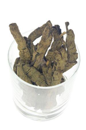 traditional chinese medicine: Ingrediente utilizado en la medicina tradicional china que figura en un moderno vidrio - Baqi (Rhizoma Smilacis chinensis)  Foto de archivo