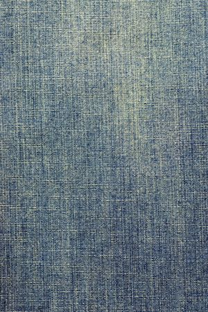 Closeup of the texture of faded denim fabric