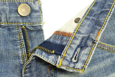 Closeup of a pair of denim jeans zipper photo