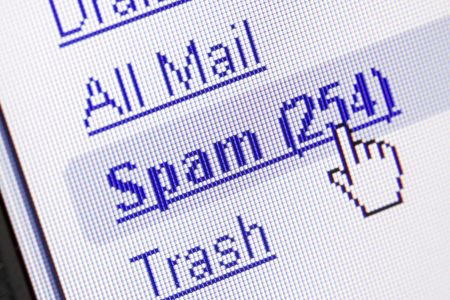 Monitor screen showing spam in the mailbox Stock Photo