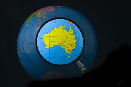 focusing: Magnifying glass focusing on Australia Stock Photo