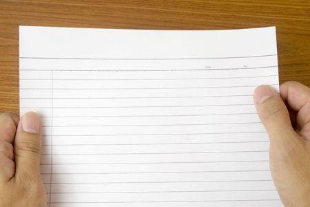 dopisní papír: Hand holding a piece of blank writing paper Reklamní fotografie