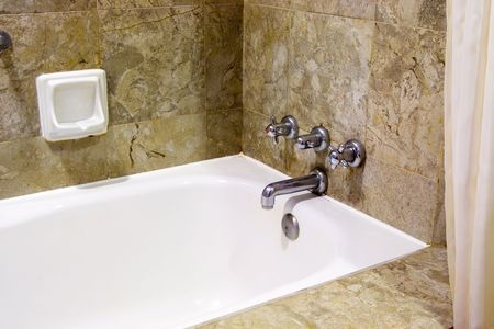 Interior of a resort hotel bathroom showing the bathtub