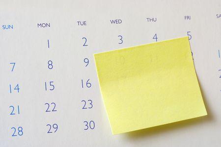 Closeup of a sticky note on a calendar