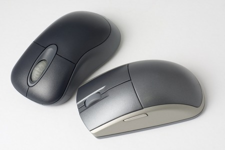 scroller: Two computer mouse isolated on white background Stock Photo