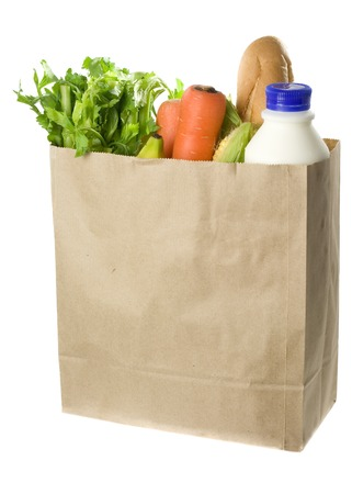 Paper bag full of groceries isolated on white background
