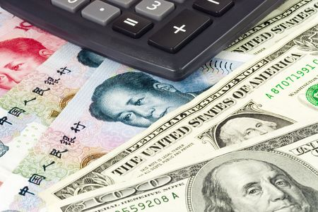 US and Chinese currency pair used in forex trading with calculator photo