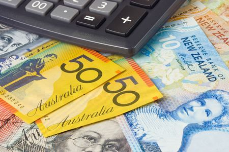 global currencies: Australia and New Zealand currency pair commonly used in forex trading with calculator Stock Photo