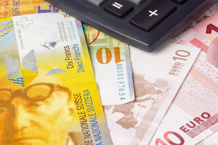 Euro and Swiss currency pair commonly used in forex trading with calculator photo