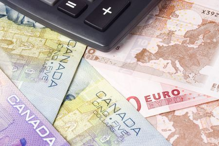 canadian currency: Canadian and Euro currency pair commonly used in forex trading with calculator Stock Photo