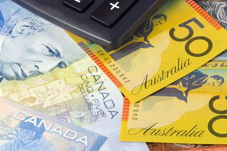 canadian currency: Australia and Canadian currency pair commonly used in forex trading with calculator Stock Photo