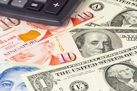 commonly: US and Singapore currency pair commonly used in forex trading with calculator Stock Photo