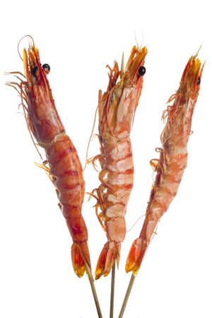 Three grilled tiger prawns on a skewer isolated on white background photo