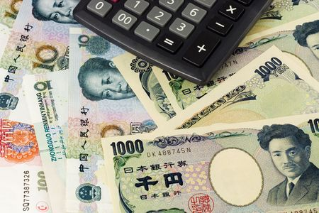 japanese currency: Chinese and Japanese currency pair commonly used in forex trading with calculator Stock Photo