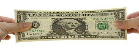 estiramientos: Las manos se extiende un d�lar de EE.UU. nota aislada en fondo blanco  Foto de archivo