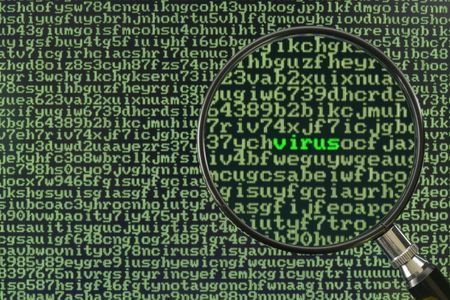 Magnifying glass focusing on the word Virus on a screen full of alphanumerics
