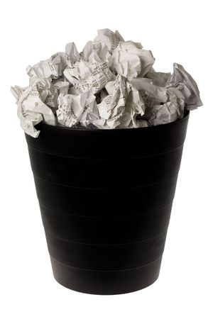 wastepaper basket: Wastepaper basket full of crumpled paper isolated on white background