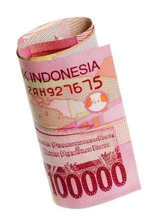 Rolled Indonesian rupiah isolated on white background