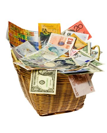 currency exchange: Basket full of currency notes of various countries Stock Photo
