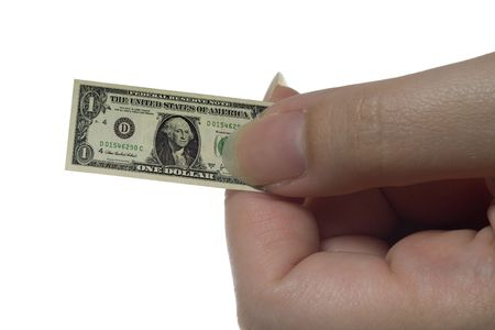 Hand holding a shrunk US dollar note isolated on white background photo