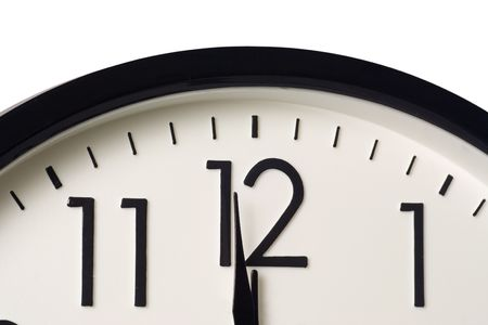 occurrence: Closeup of a clock showing one minute to midnight