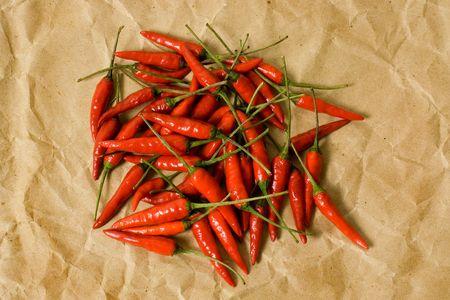 padi: Closeup of a pile of red chilli padi