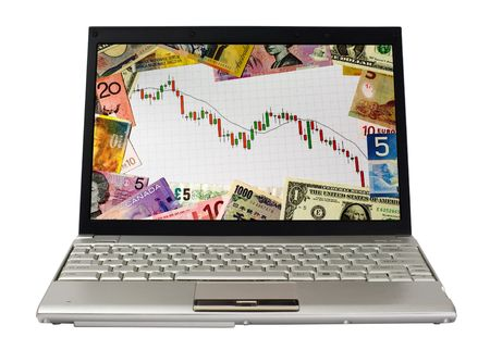Laptop showing candlestick chart of a bear market surrounded by currencies of various countries photo