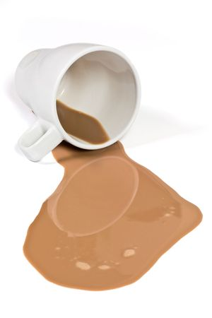 spills: White cup with some spilled chocolate milk