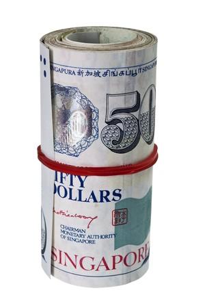 Bundle of Singapore dollar isolated on white background photo