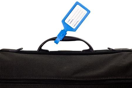 Luggage bag with identification tag isolated on white background Stock Photo