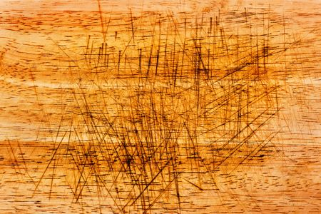 Texture of a severely scarred wood chopping board