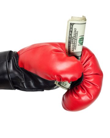 Boxing glove holding dollar bills isolated on white background photo