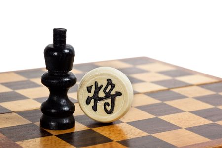 Western and Chinese Chess pieces facing each other depicting cultural difference between East and West